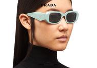 Acquista online su otticascauzillo.com il tuo nuovo occhiale da sole rettangolare stretto scultura PRADA Runway SPR 17W col. acqua